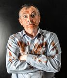 Man dirty of tomato sauce. Mad man dirty of tomato sauce Royalty Free Stock Images