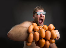 Mad man with sausages Stock Image
