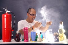 Mad man scientist. Chemical test Stock Images