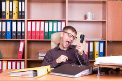 Mad man shout on the phone. Different situations from office life Royalty Free Stock Photo