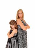 Mad mom and daughter. A mother and daughter standing back to back, isolated for white Stock Photography