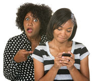Mad Mom with Teen on Phone Royalty Free Stock Photography