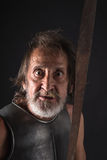 Mad old bearded warrior looking at the camera Royalty Free Stock Photography