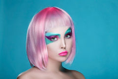 Mad Portrait of Girl with Hands with face art and pink wig. Idea Royalty Free Stock Photo