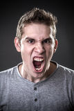 Mad. Portrait of a normal boy looking at camera mad Royalty Free Stock Photography