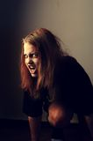 Mad possessed girl Stock Image