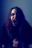 Mad possessed girl. Mad possessed by a demon girl shouting Stock Photography