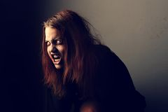 Mad possessed girl Stock Photography