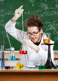 Mad professor adds something to the Erlenmeyer flask Stock Image