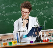 Mad professor considers the results Stock Photo