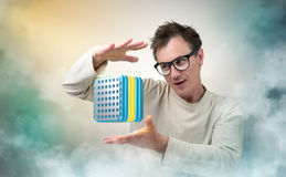 Mad Professor and device. On smoke background stock image