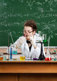 Mad professor does the experiment. In his laboratory Royalty Free Stock Image