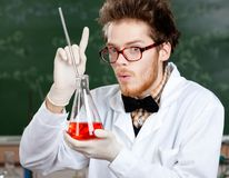 Mad professor gestures forefinger holding Royalty Free Stock Photo