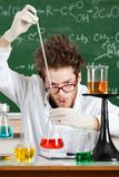 Mad professor holds some experiments Royalty Free Stock Images