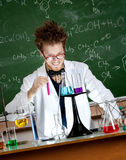 Mad professor holds a vial Stock Image