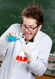 Mad professor mixes two liquids Stock Photography