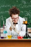 Mad professor puts on a white rubber gloves Royalty Free Stock Photos