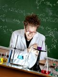 Mad professor rubs hands. Working in his laboratory Stock Photo