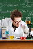 Mad professor is shocked with the result of tests. In his laboratory Royalty Free Stock Photography