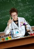 Mad professor shows forefinger. Showing forefinger mad professor is in his laboratory stock images