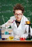 Mad professor tastes the liquid Stock Images