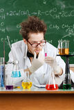 Mad professor thinks about the result of the experiment. In his laboratory Stock Photo