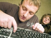 The mad programmer with the keyboard. Royalty Free Stock Images