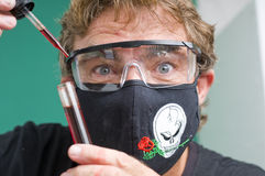 Mad scientist. Man with wild and crazy eyes  working in a medical lab Stock Photo