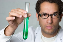 Mad Scientist. Holding test tube Royalty Free Stock Photo