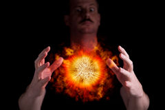 Mad scientist. Is using superpower to cause an explosion Stock Photo