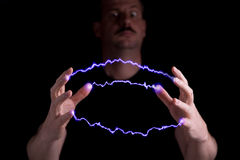 Mad scientist. Is using superpower to cause an electrical arc Stock Photo