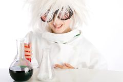 Mad Scientist. A child dressed as a Mad Scientist in a laboratory Stock Images