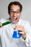 Mad Scientist. Mad crazy scientist mixing chemicals Stock Image