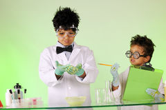 Mad Scientist Brothers at Work Royalty Free Stock Photography