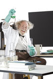 Mad scientist conducts chemistry experiment royalty free stock photos