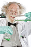 Mad scientist conducts chemistry experiment Royalty Free Stock Image