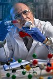 Mad scientist doing experiment on lab mouse stock image
