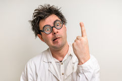Mad scientist got the great idea. In his laboratory Stock Photography