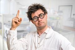 Crazy scientist got the great idea in his laboratory Royalty Free Stock Image