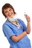 Mad scientist holding filled syringe. Mad female scientist holding a filled syringe, ready to inject someone Royalty Free Stock Images