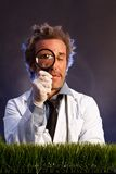 Mad Scientist with Magnifying Glass Royalty Free Stock Photography