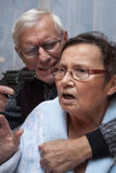 Mad senior with a gun Stock Photos