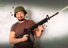 Mad shooting man Stock Images