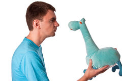 Mad stare at the blue teddy giraffe Stock Image