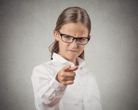 Mad teenager girl disguised as boss pointing finger at you Royalty Free Stock Images