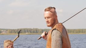 Mad vikings on the Drakkar on the river shore.  stock footage