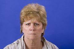 Mad woman. Mature woman a bit angry royalty free stock photo
