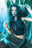 Mad woman mermaid in green net Royalty Free Stock Image