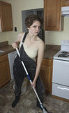 Mad woman mopping floor Royalty Free Stock Photos