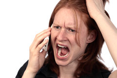 Mad Woman on the Phone. A young woman yelling on the phone. Photographed over white background Royalty Free Stock Photos